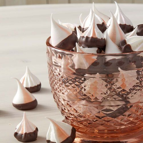 Striped Champagne Meringue Cookies in a bowl