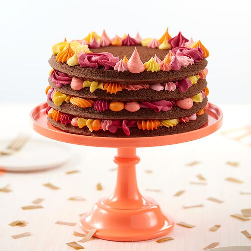 Shades of Citrus Chocolate Cake with pink, yellow, and orange frosting