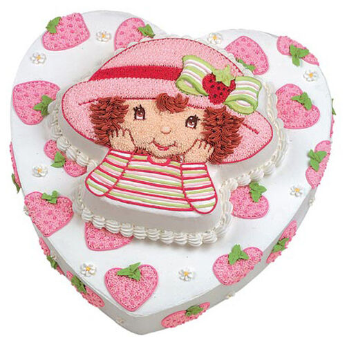 Heart cake decorated with pink icing strawberries and a Strawberry Shortcake cake tier on top