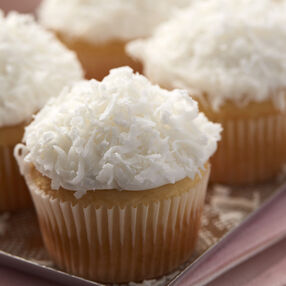 Almond Coconut Cupcakes with shaved coconut on top