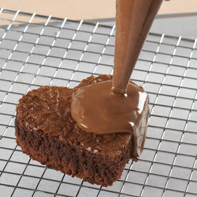 Pouring Thinned Icing or Candy Melts over Cut Cake