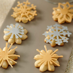 Christmas Spritz Cookies With Metallic Candy Snowflakes