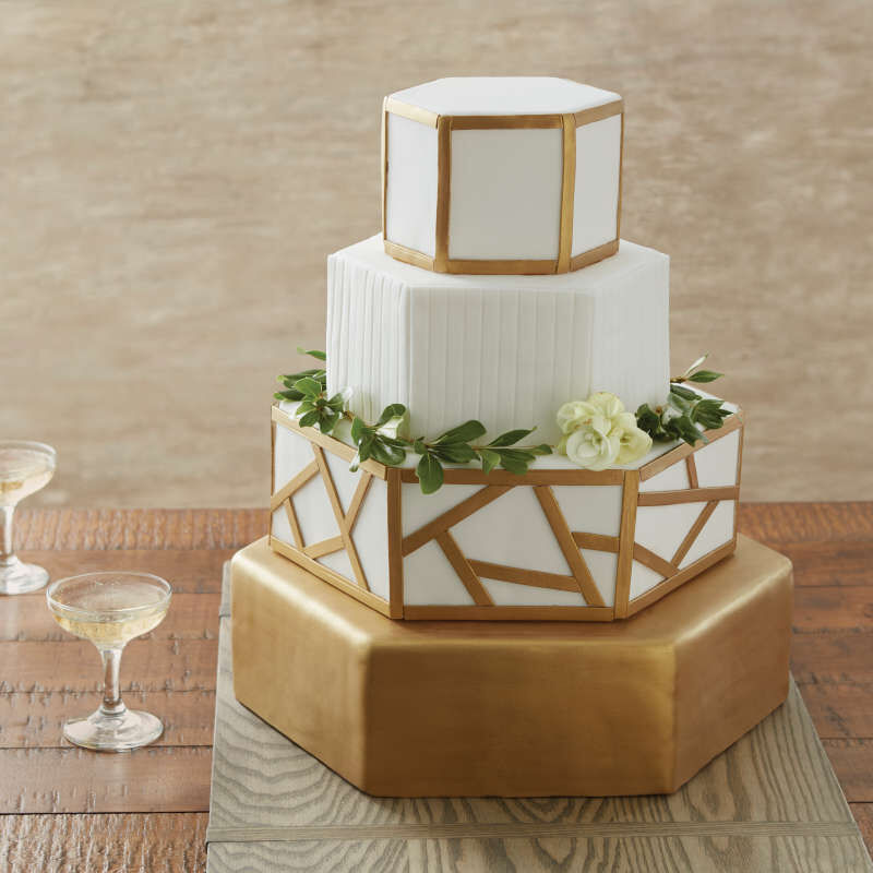 White and Gold Tiered Hexagon Wedding Cake image number 3