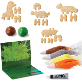 Cookie Creations Jungle Animal Cookie Kit - Box contains 14 pre-baked cookie pieces^brown, grey, orange, yellow and black icing^green and brown fondant^4 decorating bags^4 round tips^jungle presentation board