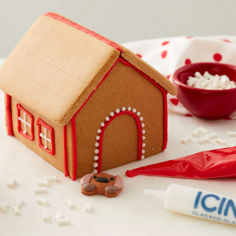 Gingerbread Doghouse Being Decorated
