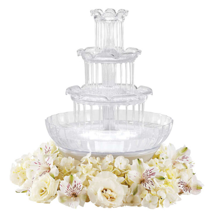 Mini Water Fountain Surrounded by White Flowers