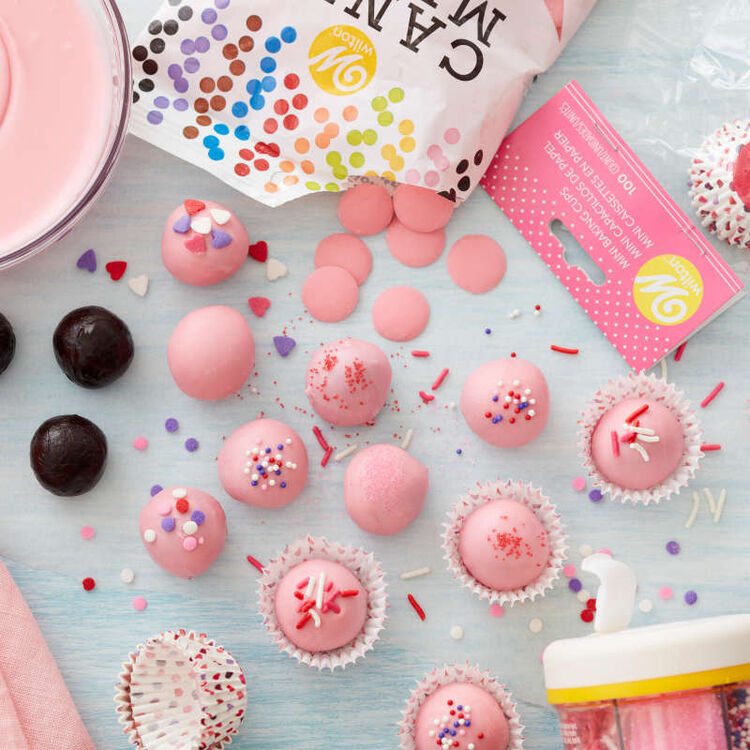 Light pink Candy Melt-covered hot chocolate bombs