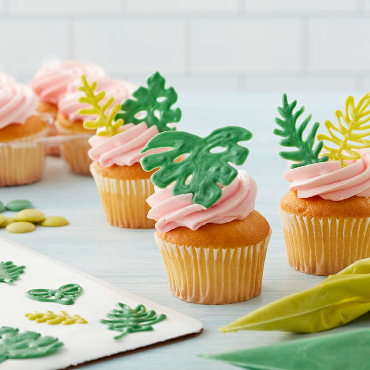 Candy Melt piped leaves atop cupcakes