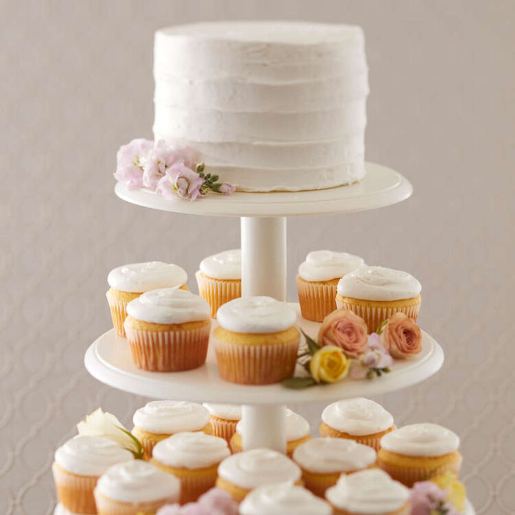 Close Up of White Cake and Cupcakes on Stand