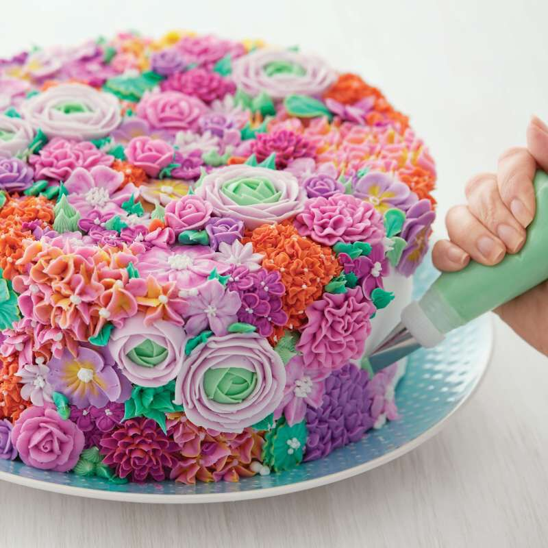 Decorating a Colorful Floral Cake image number 4