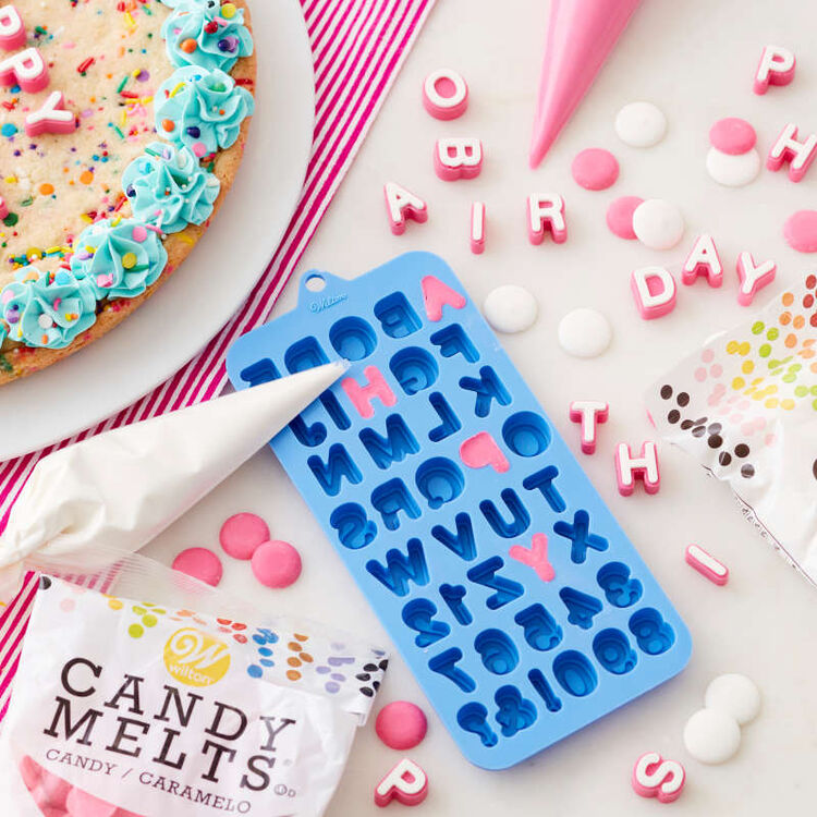 White and Pink letters made out of candy melts