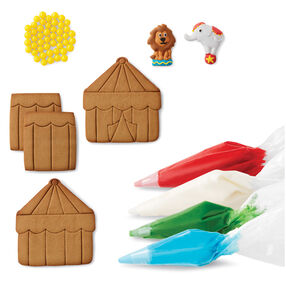 4 pre-baked cookie panels^white, red, blue and green icing^yellow candies^elephant and lion icing decorations^4 decorating bags^3 round tips^1 star tip