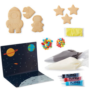 Cookie Creations Space Exploration Cookie Kit -  6 pre-baked cookie pieces^grey, white, blue, red, black and yellow icing^round and star candies^2 decorating bags^2 round tips^space presentation board