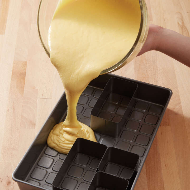 Pouring Cake Batter into Numbers and Letters Cake Pan image number 4