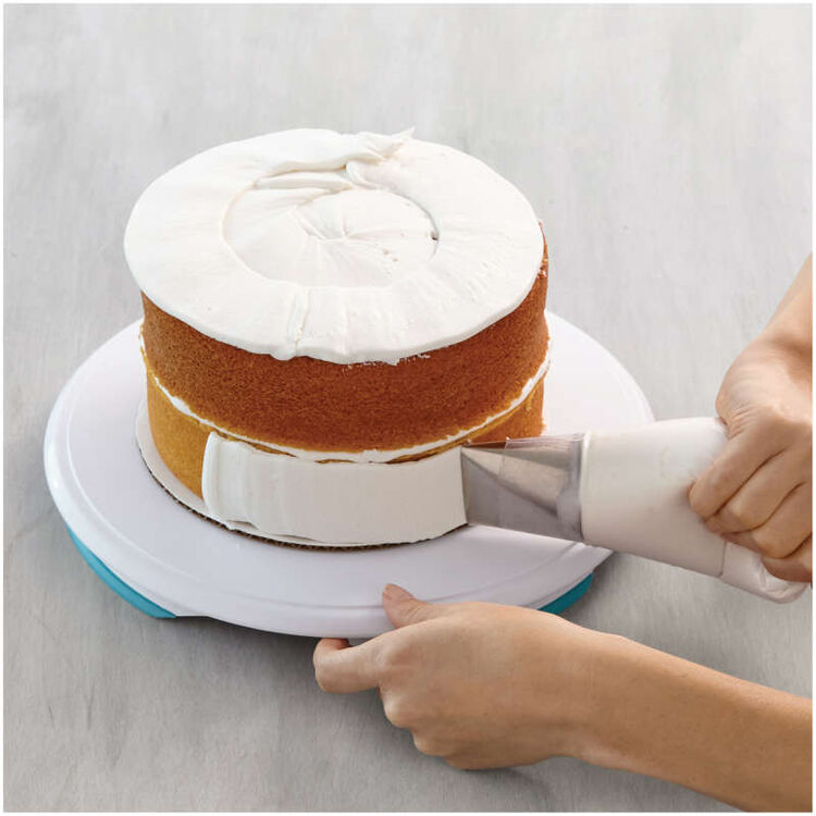 Piping Frosting Around a Cake