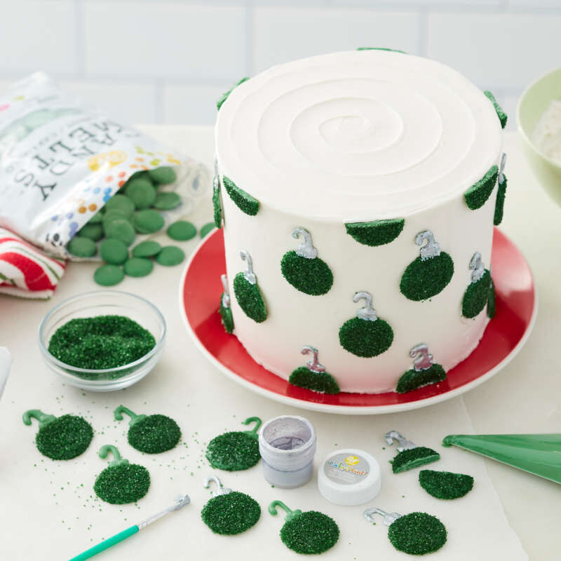 Green Candy Melt wafers covered in green sparkling sugar and attached to a cake to look like ornaments image number 5