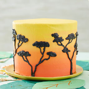 African Sunset Cake, yellow and orange sunset with piped tree shadows