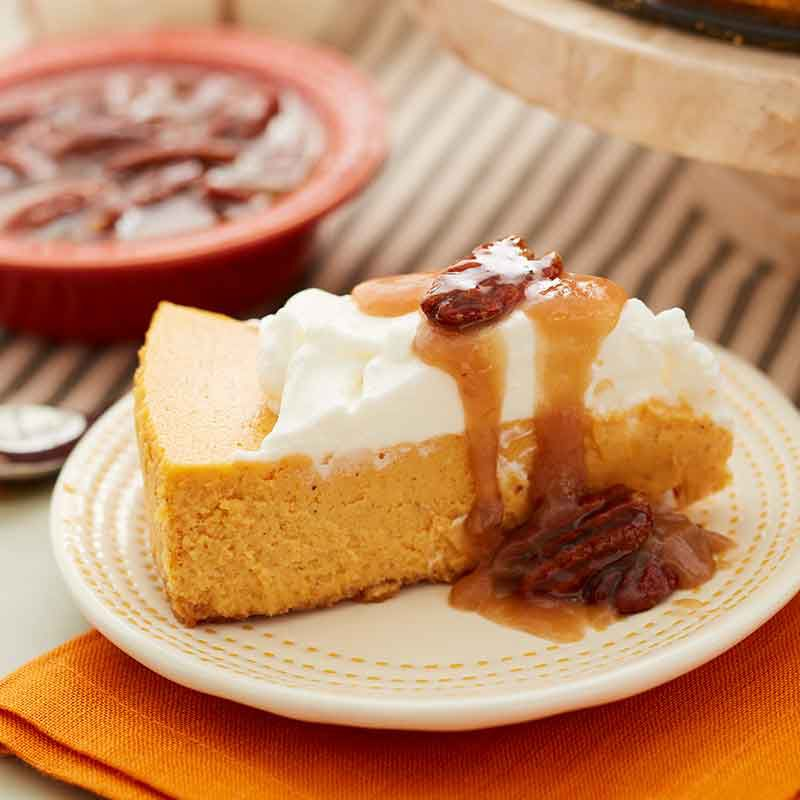 pumpkin cheesecake with caramel pecan topping image number 0