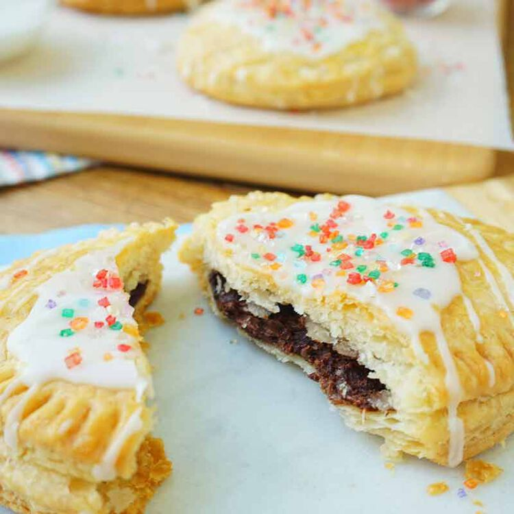 hazelnut spread filled breakfast pies topped with frosting and sprinkles