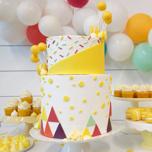 Yellow Bright Two-Tiered Triangle Cake