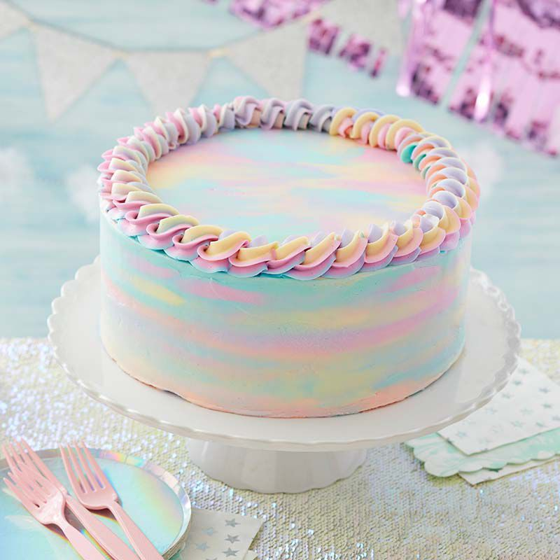 Cake decorated with pastel colored buttercream, spread to look like watercolors image number 0