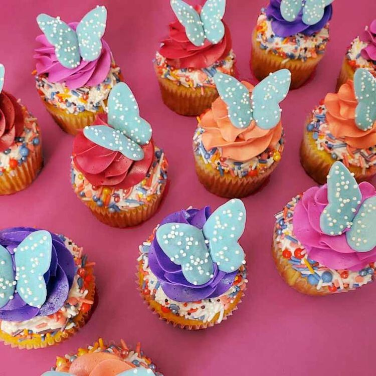 cupcakes decorated with buttercream frosting and candy melts candy butterfly toppers