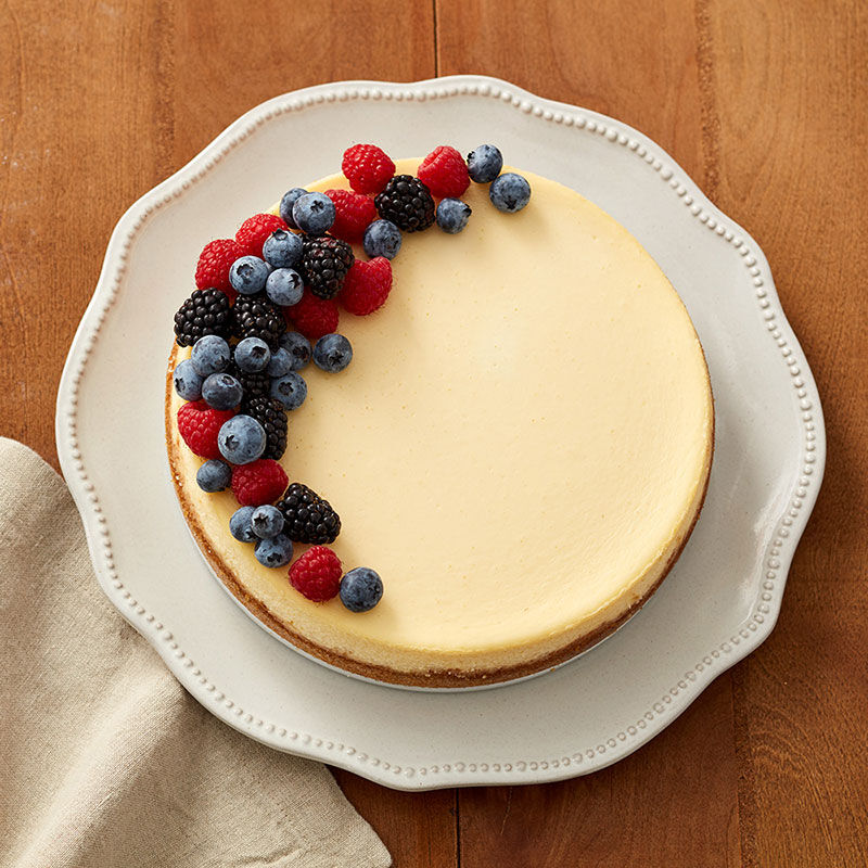 Classic cheesecake topped with fresh berries image number 0