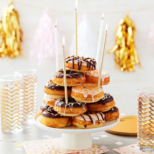 All the Glitters is Gold Donut Cake - Stacked donut cake with vanilla and chocolate glaze and gold candles