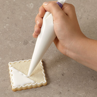 How to cover a cookie with cookie icing