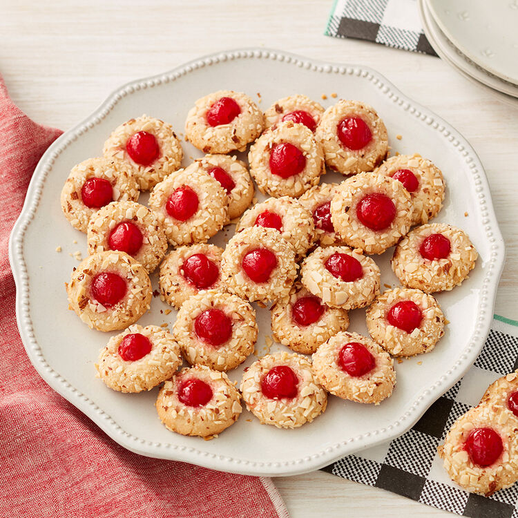 Cookies covered in almonds with a cherry center