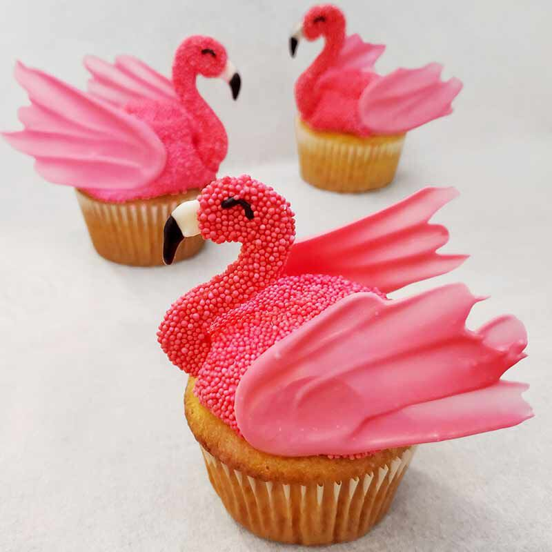 pink cupcakes with flamingo toppers made from pink candy melts candy image number 0