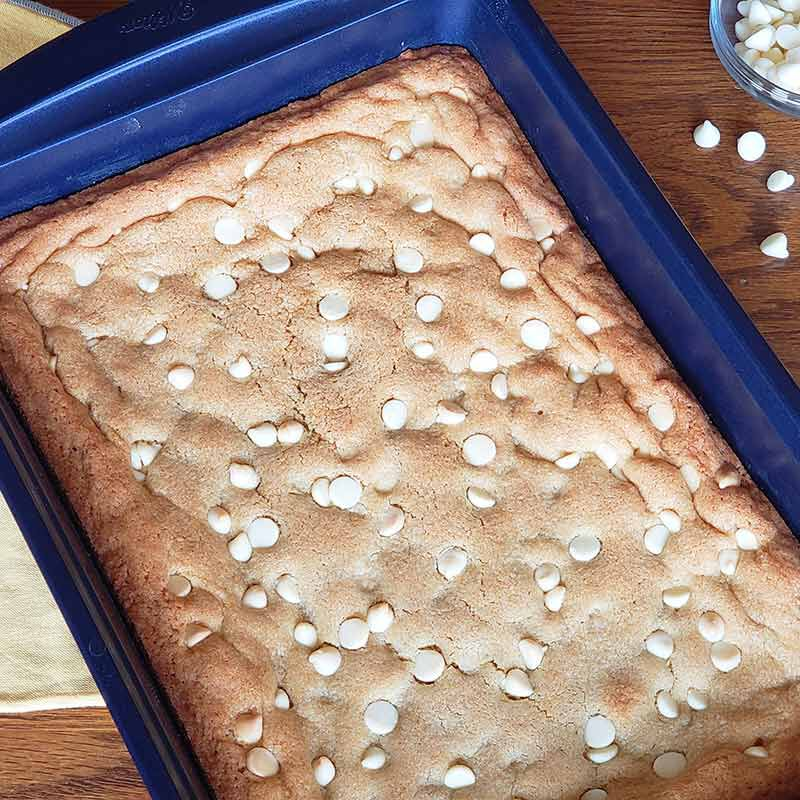 white chocolate chip blondies in a pan image number 0