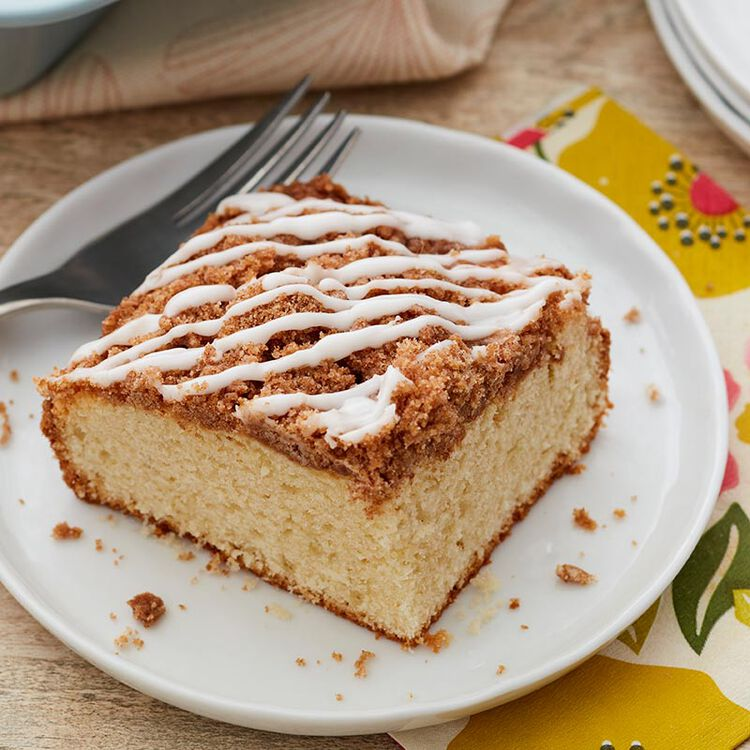 Coffee cake topped with cinnamon and icing