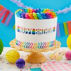 """Trendy Birthday cake featuring rainbow buttercream frosting, a fault line in the middle of the cake, and """"Happy Birthday""""."""