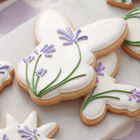 Blooming Easter Cookies, white royal icing with lavender flowers on top