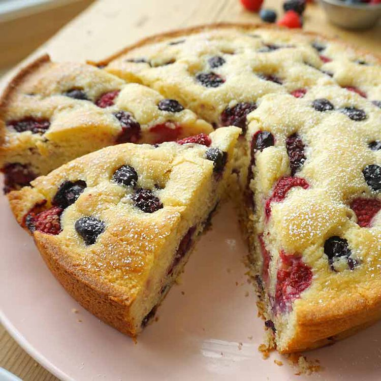 mixed berry cake cut open to show berries inside