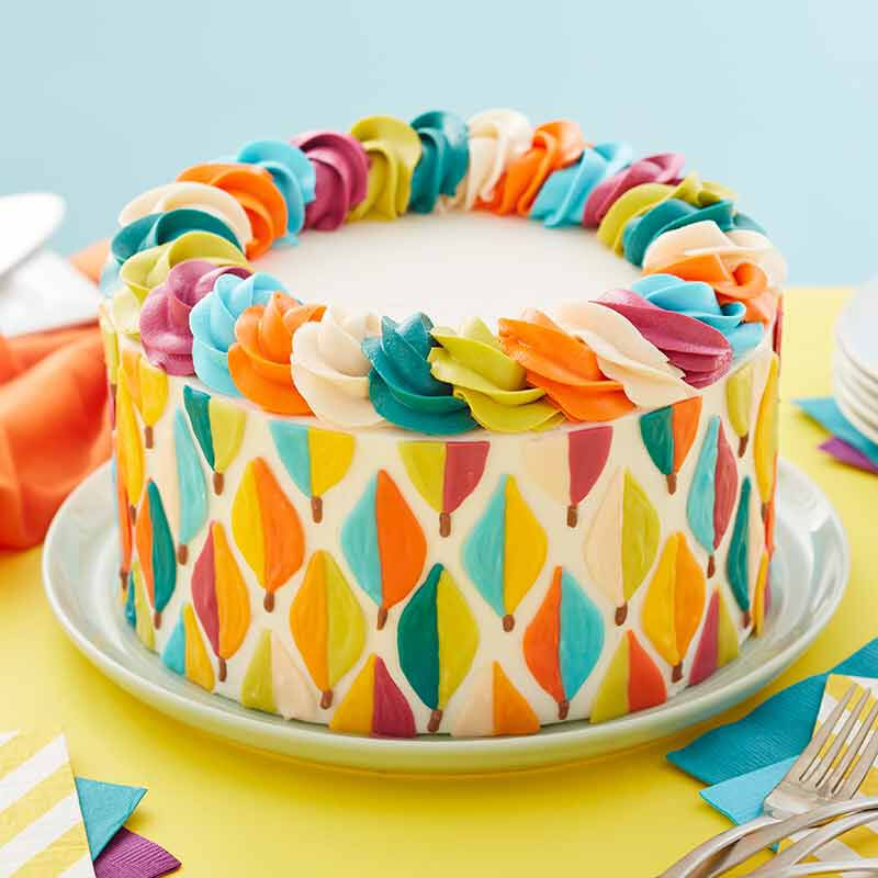 fall cake decorated with fall candy melts candy colored leaves image number 0