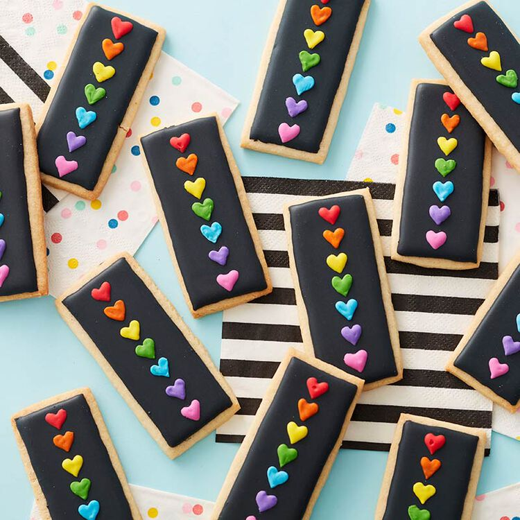 Rectangular cookies decorated with a black background and colorful hearts