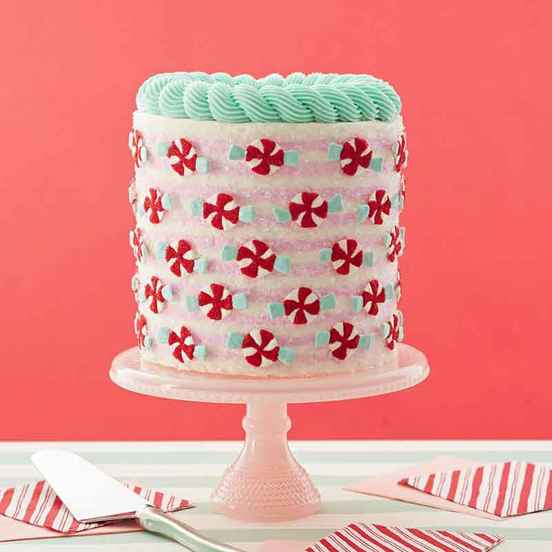 christmas cake with peppermint decorations image number 0