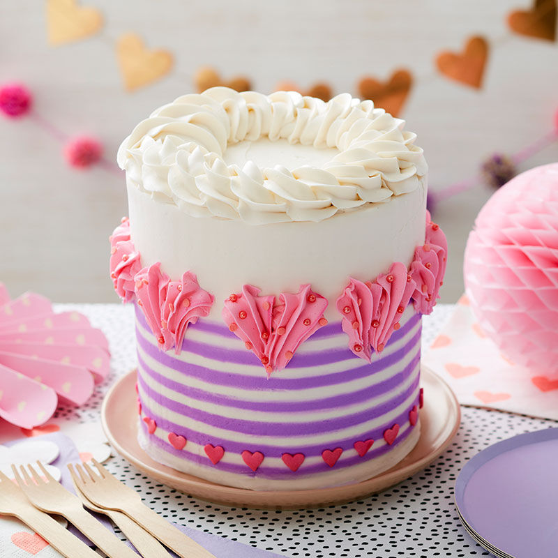 Valentine's Day striped buttercream cake with 1M piped hearts and heart sprinkles image number 0