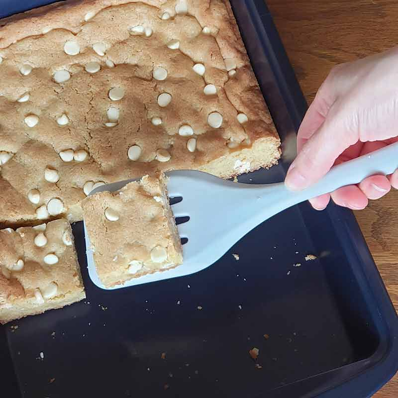 white chocolate chip blondies being served image number 2