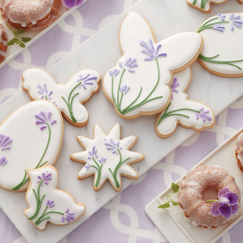 Blooming Easter Cookies, white royal icing with lavender flowers on top image number 0