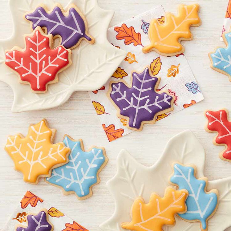 leaf shaped sugar cookies piped with royal icing
