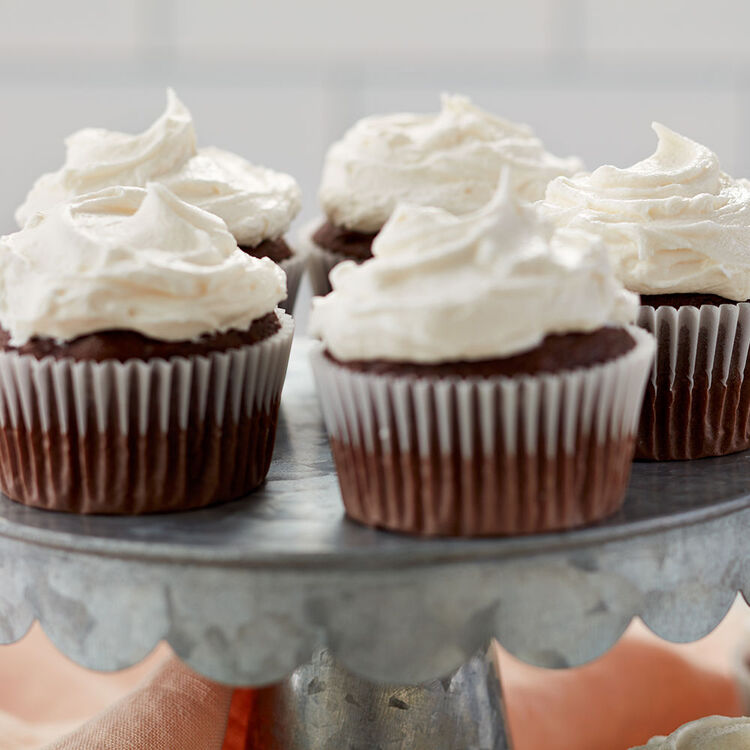 Frosted chocolate cupcakes close up