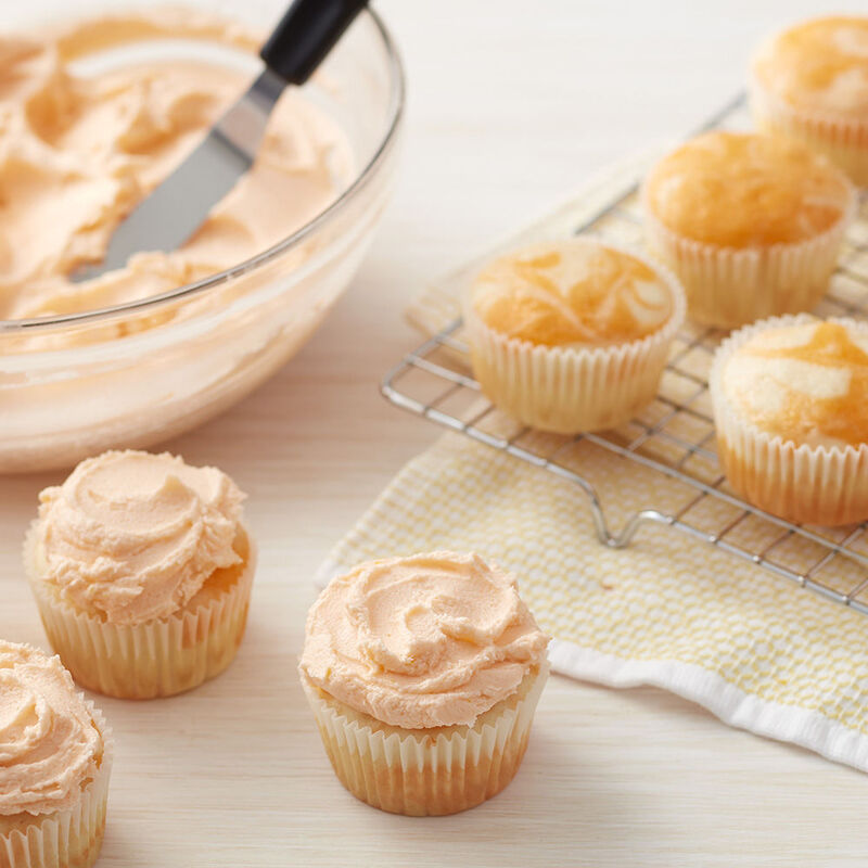 Orange Buttercream Frosting on Vanilla Cupcakes image number 0