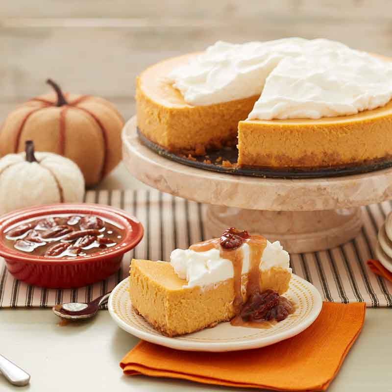 pumpkin cheesecake with caramel pecan topping image number 1