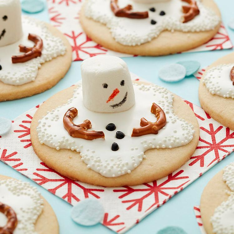 Melted Snowman Sugar Cookies with marshmallow head and pretzel arms