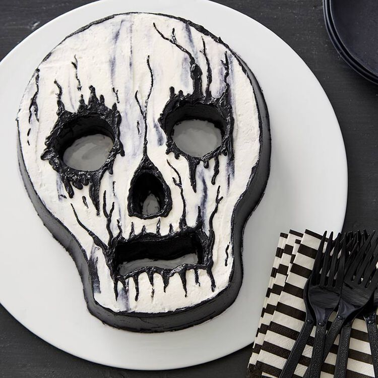 Skull-shaped cake with white and black buttercream frosting