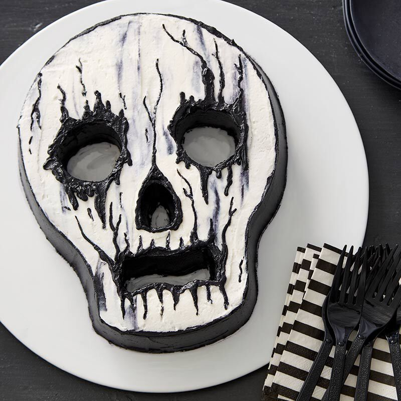 Skull-shaped cake with white and black buttercream frosting image number 0