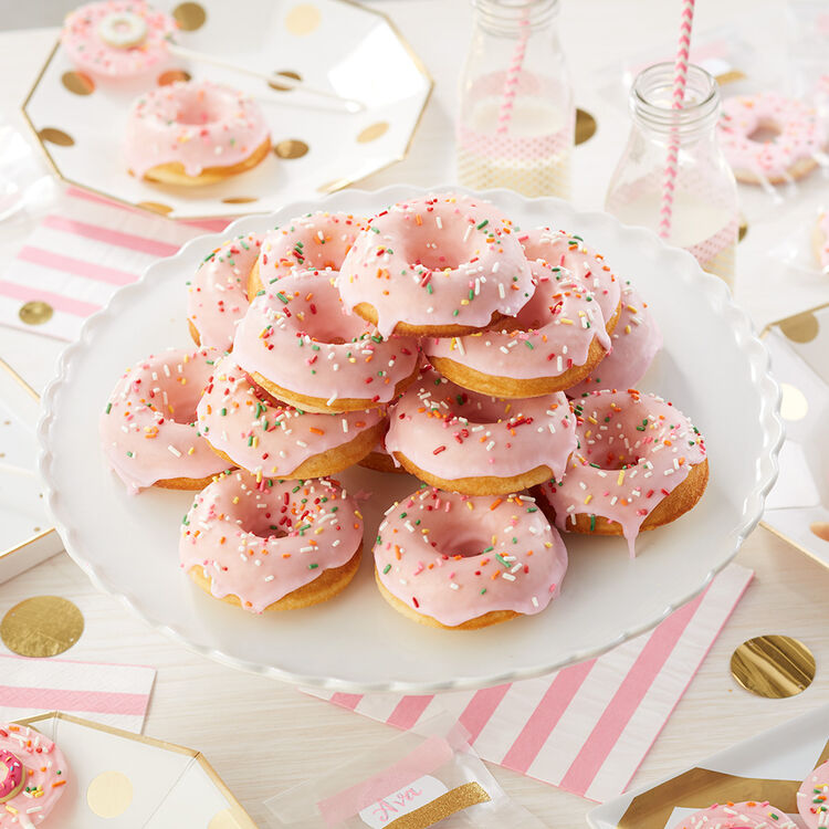 Party in Pink Donut Cake - Pink iced donuts, stacked on a cake pedestal with rainbow sprinkles